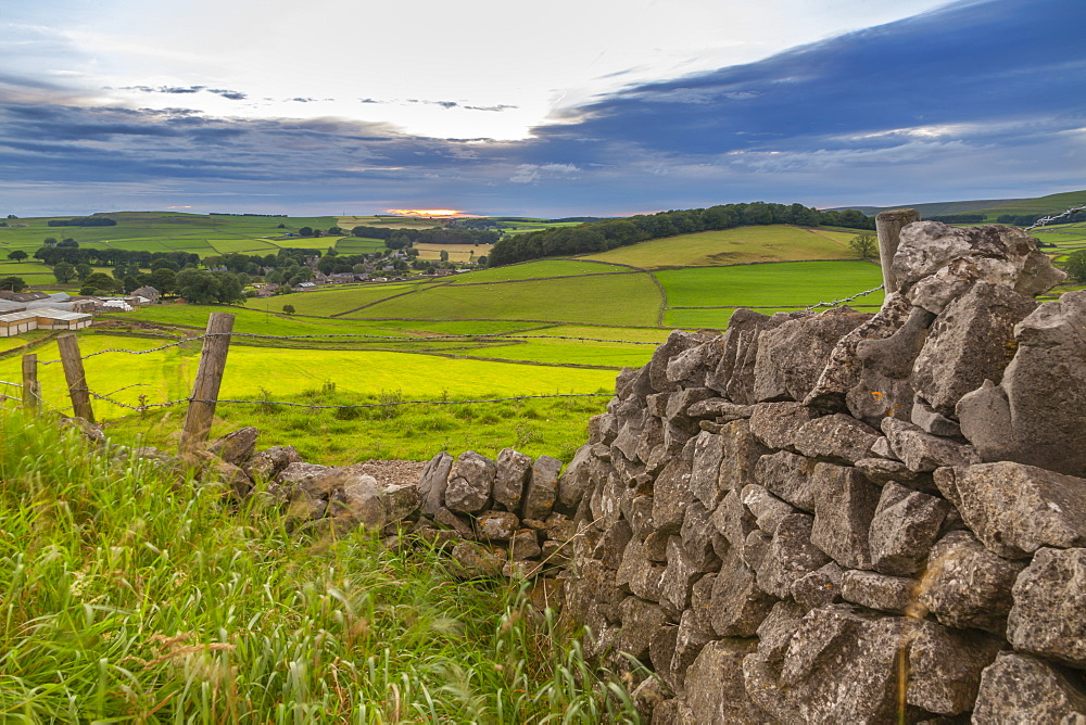 View of sunset and dry stone wall overlooking Peak Forest, Peak District National Park, Derbyshire, England, United Kingdom, Europe