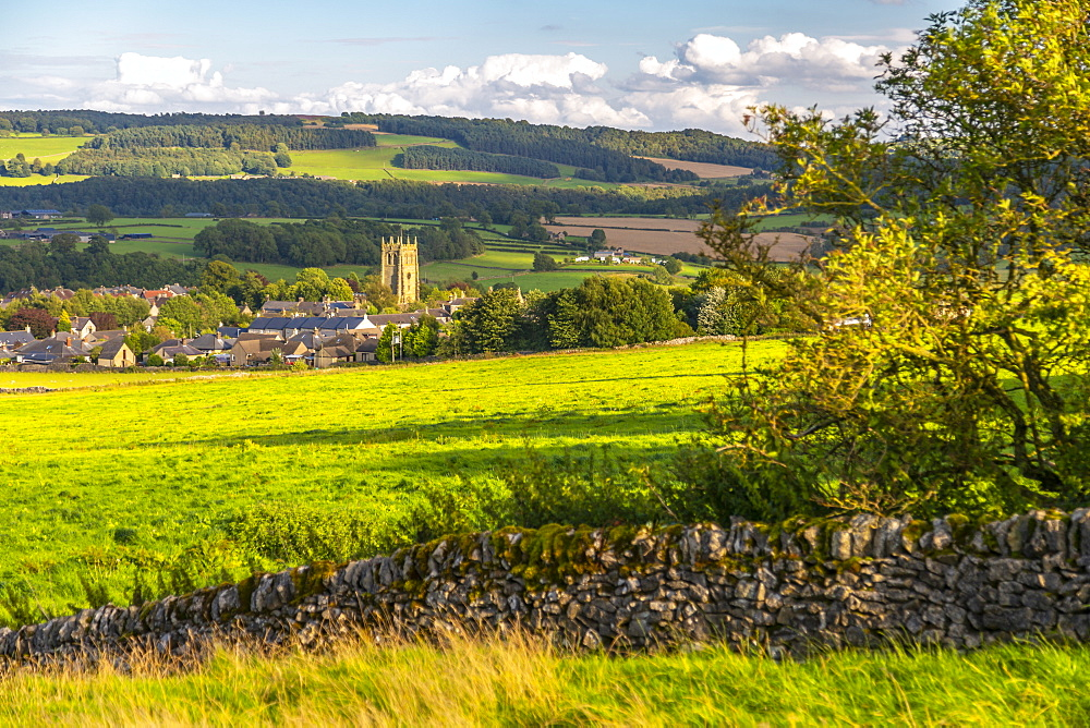 View of dry stone walls and Youlgrave village, Peak District National Park, Derbyshire, England, United Kingdom, Europe