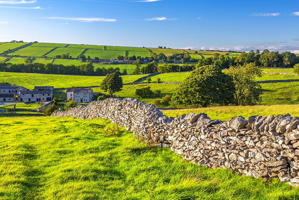 View of dry stone walls and Over Haddon village, Peak District National Park, Derbyshire, England, United Kingdom, Europe