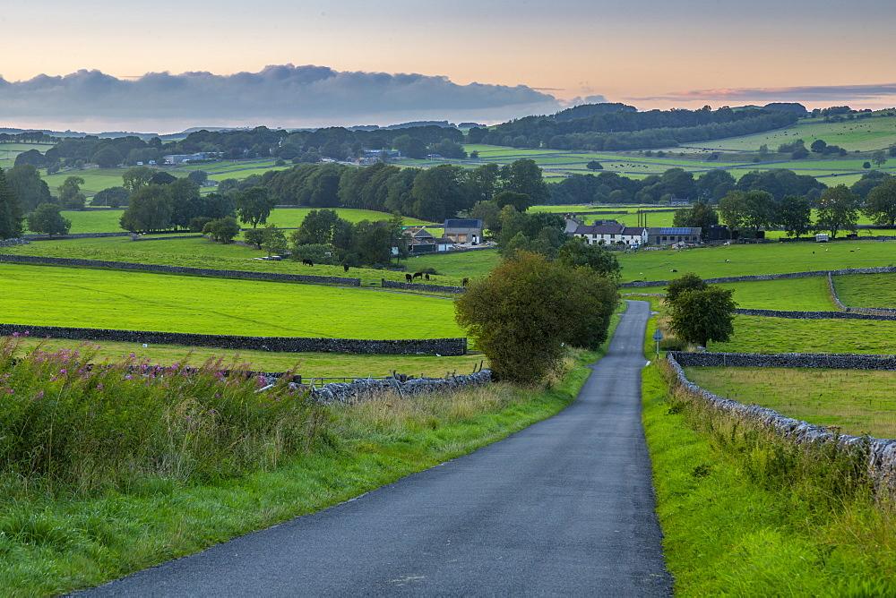 View of dry stone walls and Biggin village, Peak District National Park, Derbyshire, England, United Kingdom, Europe