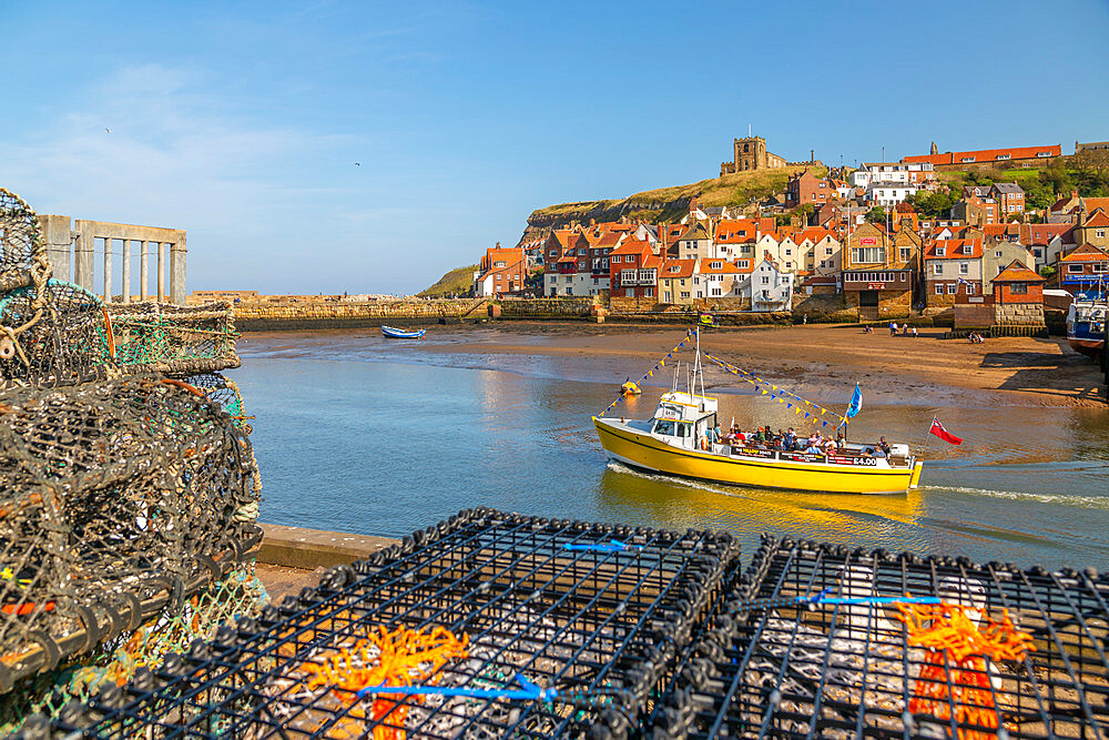 View of St. Mary's Church and restaurants, houses and boats on the River Esk, Whitby, Yorkshire, England, United Kingdom, Europe - 844-23328
