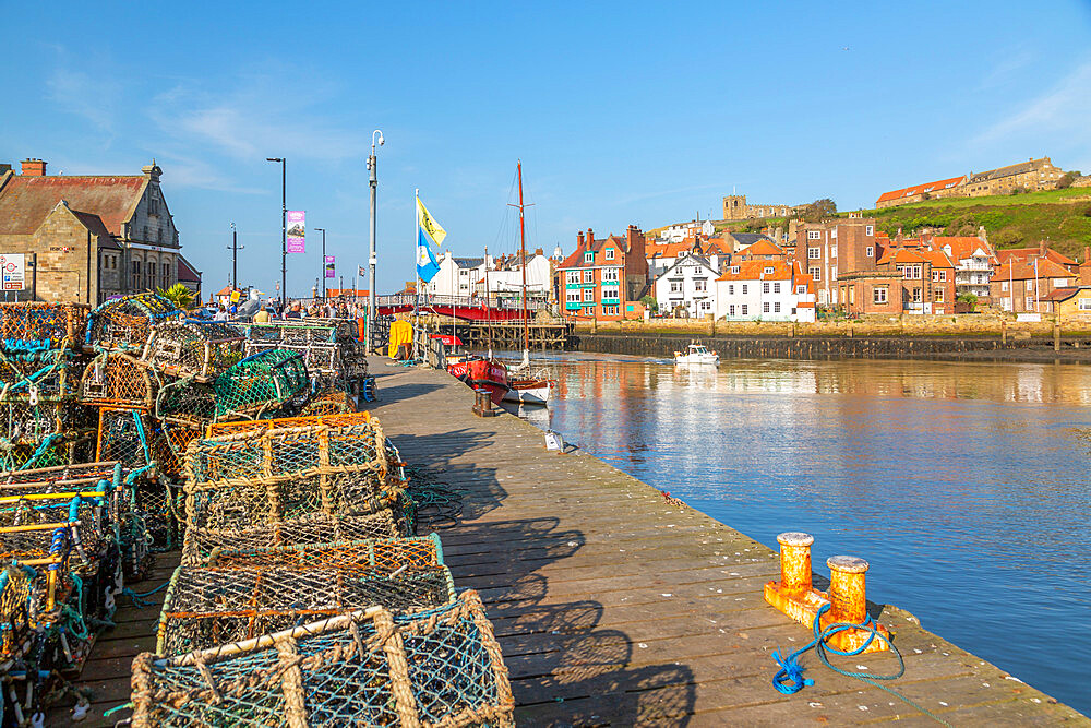View of St. Mary's Church and fishing baskets, houses and boat on the River Esk, Whitby, Yorkshire, England, United Kingdom, Europe - 844-23330