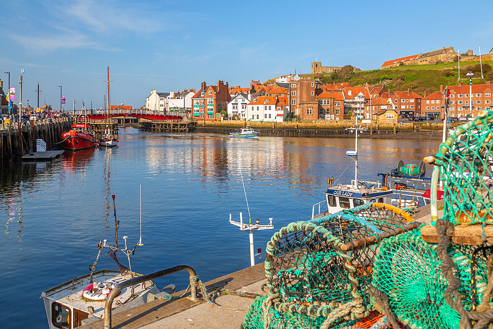 View of St. Mary's Church and fishing baskets, houses and boat on the River Esk, Whitby, Yorkshire, England, United Kingdom, Europe - 844-23332