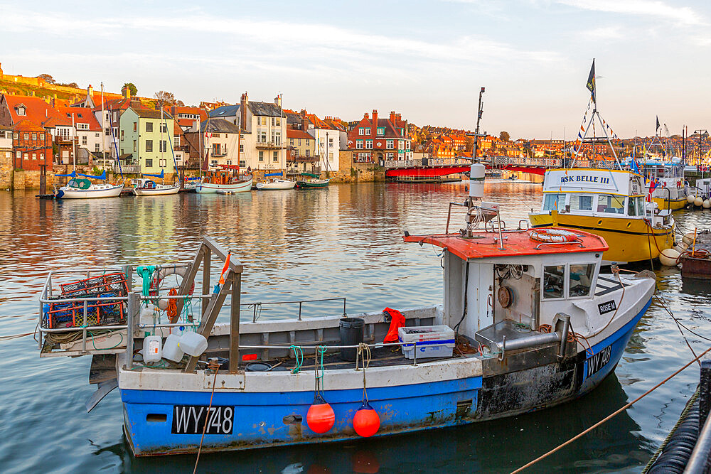 View of riverside houses and fishing boats on River Esk at sunset, Whitby, Yorkshire, England, United Kingdom, Europe - 844-23338