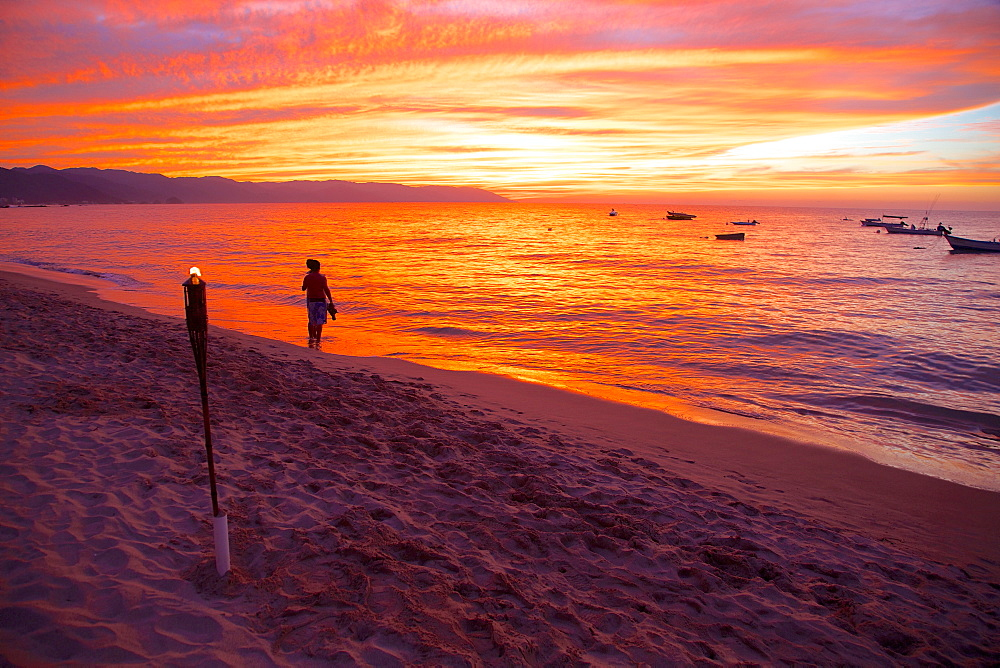Torch and couple on the beach in Downtown at sunset, Puerto Vallarta, Jalisco, Mexico, North America