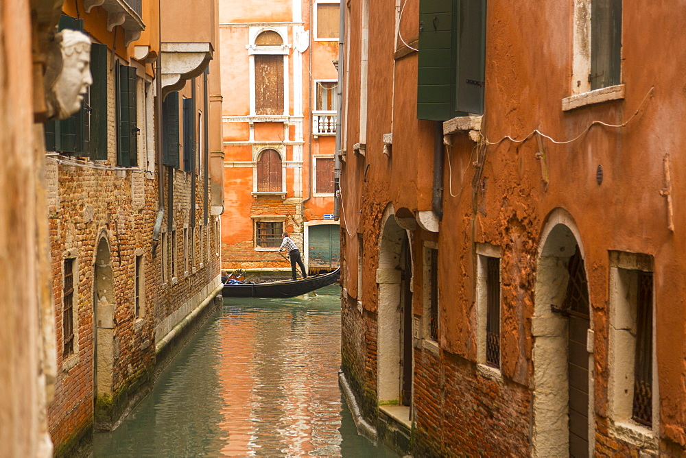 Canal and gondolier, Venice, UNESCO World Heritage Site, Veneto, Italy, Europe