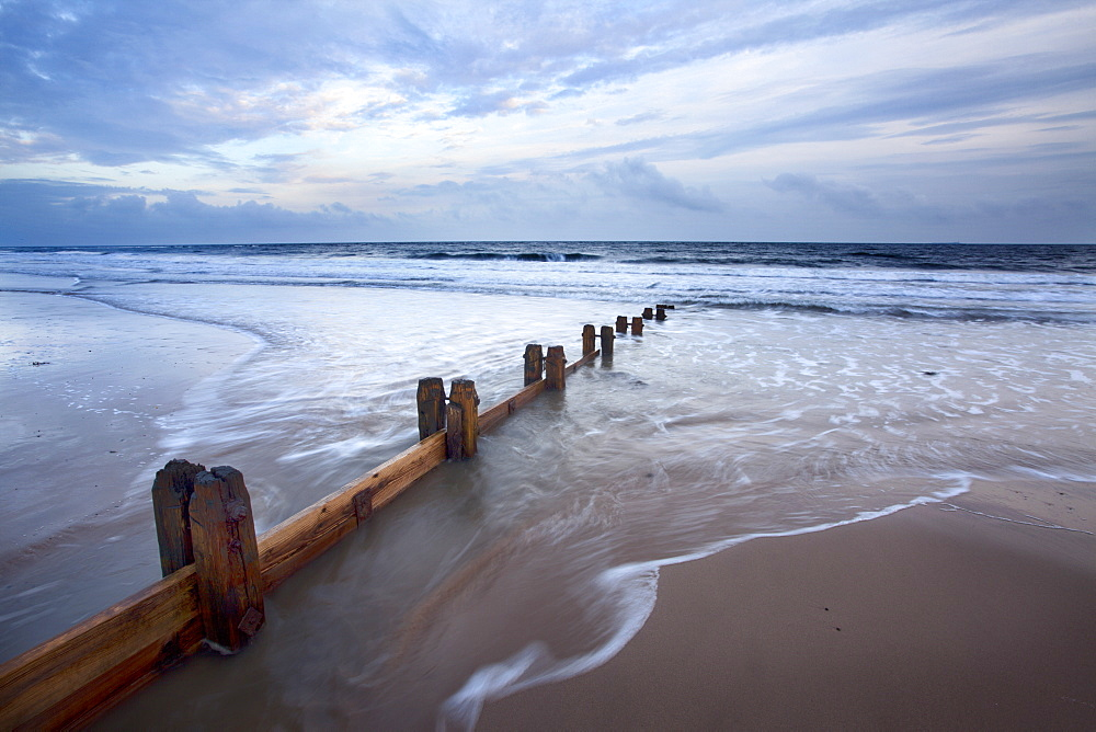 Groynes and receding tide on Alnmouth Beach at dusk, Northumberland, England, United Kingdom, Europe - 845-1027