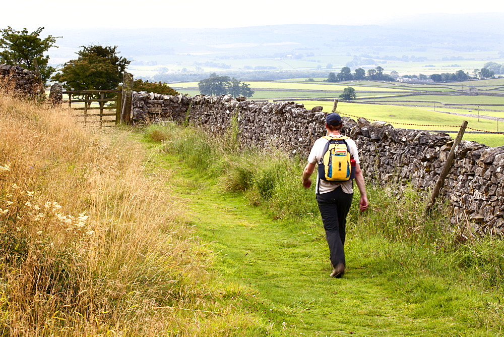 Walker on a Public Footpath in Crummack Dale, Yorkshire, England, United Kingdom, Europe - 845-986