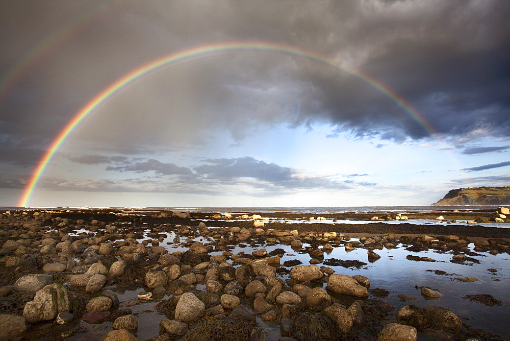 Rainbow over the sea at Robin Hoods Bay, Yorkshire, England, United Kingdom, Europe - 845-996
