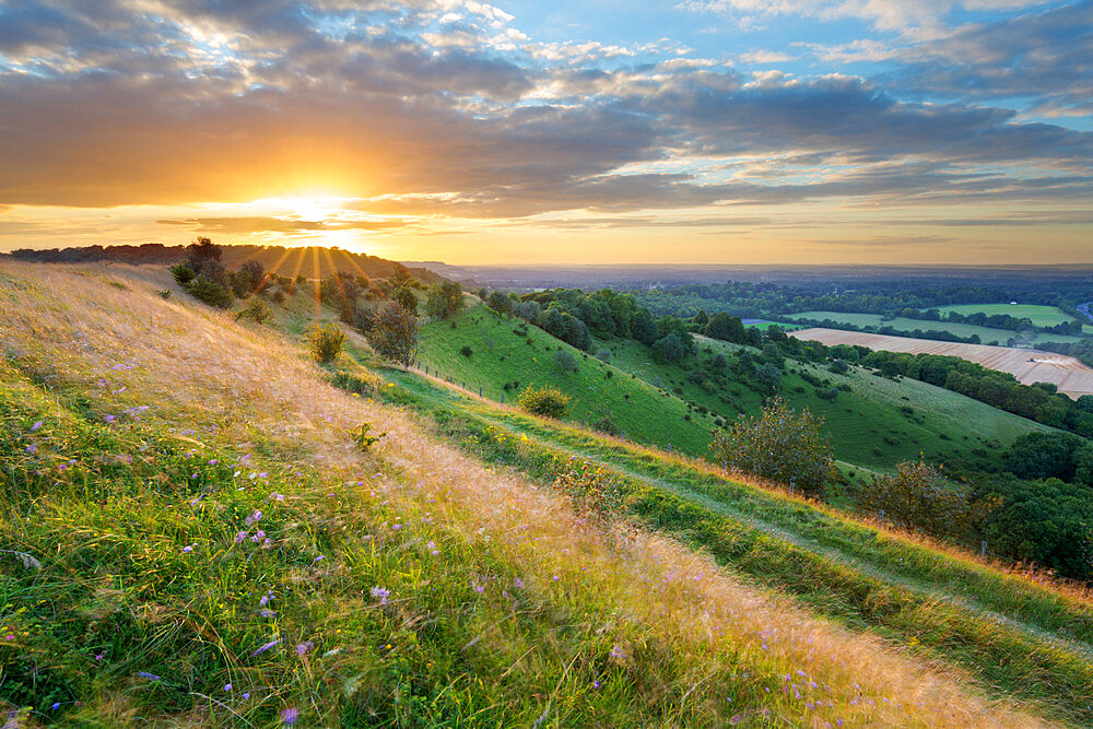 Sunset over Iron-Age hill fort of Beacon Hill, near Highclere, Hampshire, England, United Kingdom, Europe