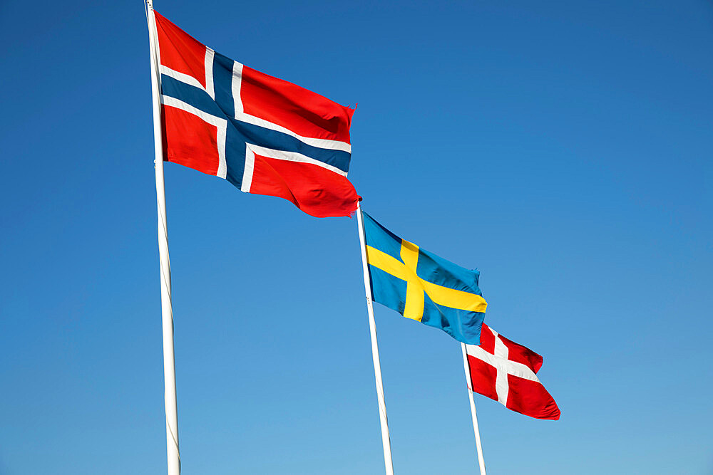 Scandinavian country flags against blue sky, Hornbaek, Kattegat Coast, Zealand, Denmark, Scandinavia, Europe - 846-2782