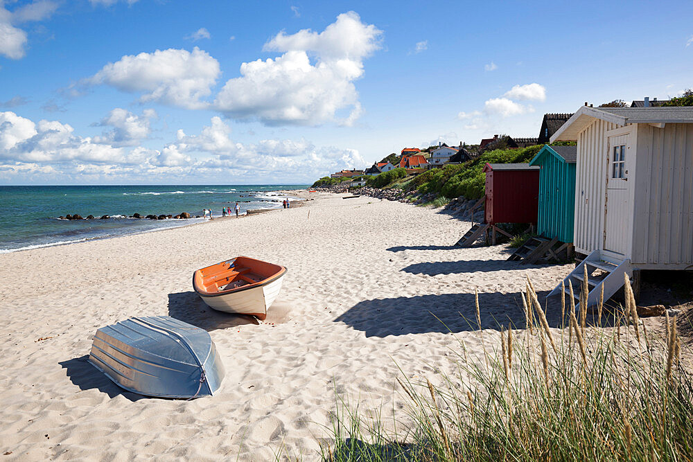 Boats and beach huts on white sand beach with town behind, Tisvilde, Kattegat Coast, Zealand, Denmark, Scandinavia, Europe