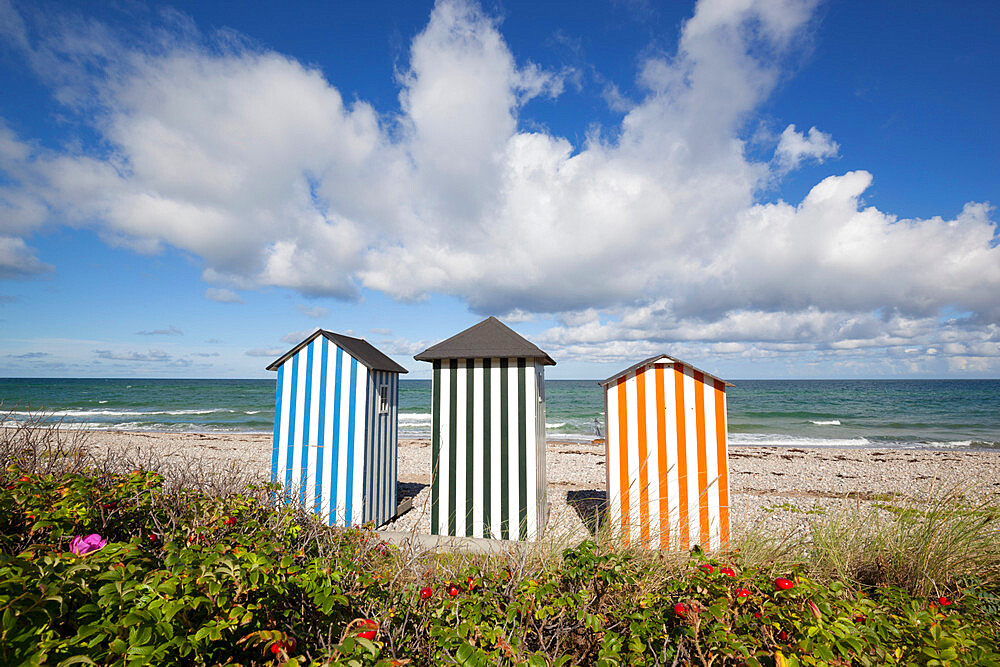 Colourful beach huts on pebble beach with blue sea and sky with clouds, Rageleje, Kattegat Coast, Zealand, Denmark, Scandinavia, Europe - 846-2790