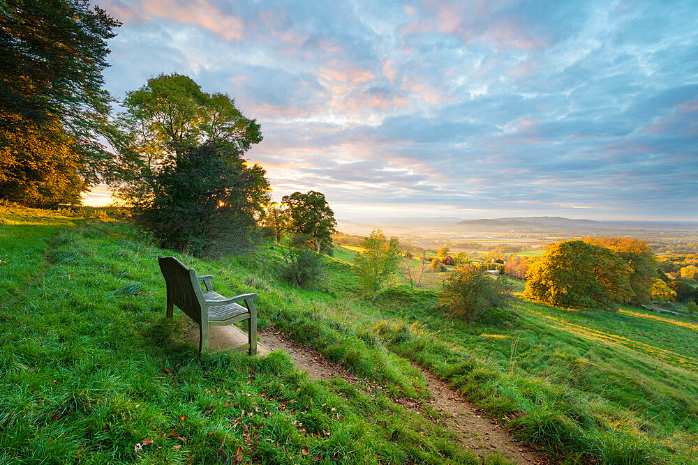 Cotswold Way path and bench with views to the Malvern Hills at sunset, Ford, Cotswolds, Gloucestershire, England, United Kingdom, Europe - 846-2800