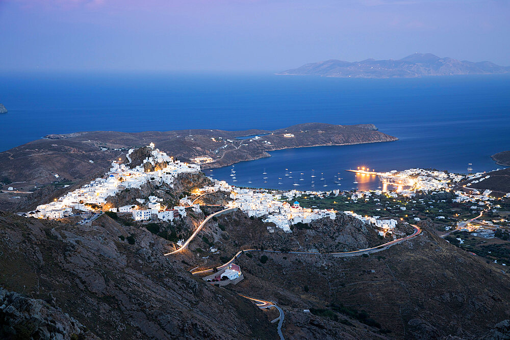 View over Livadi Bay and hilltop town of Pano Chora at night, Serifos, Cyclades, Aegean Sea, Greek Islands, Greece, Europe