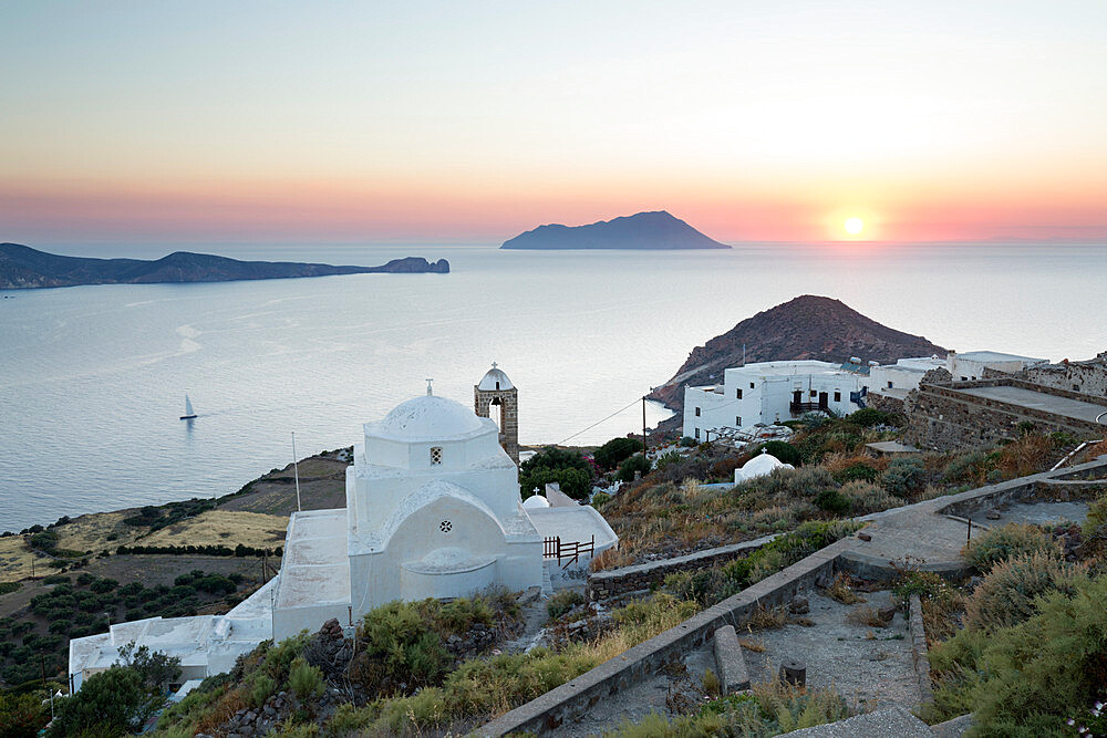 White Greek church and Milos Bay from Plaka Castle at sunset, Plaka, Milos, Cyclades, Aegean Sea, Greek Islands; Greece, Europe