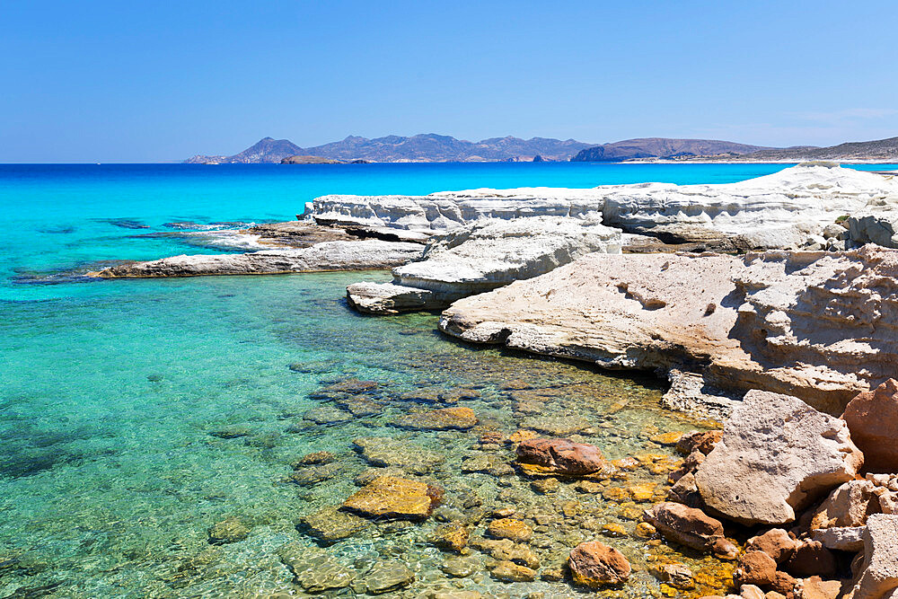 Clear turquoise sea and volcanic rock formations at Sarakiniko, Sarakiniko, Milos, Cyclades, Aegean Sea, Greek Islands, Greece, Europe