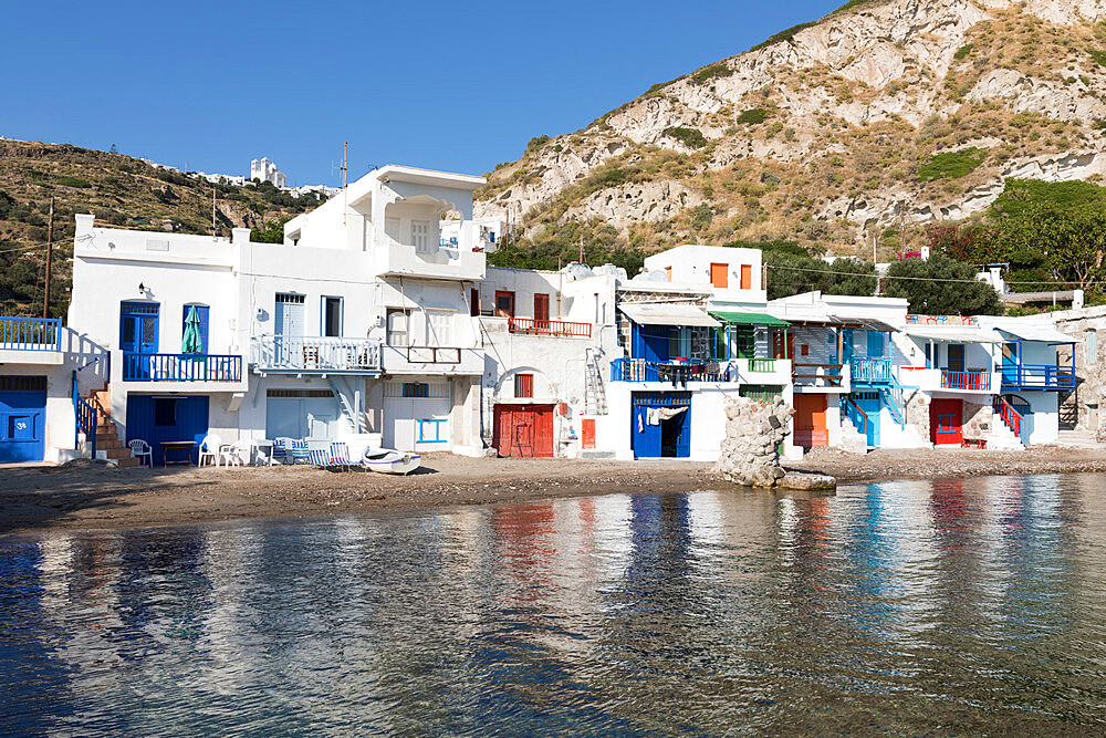 Colourful fishermen's boat houses with Plaka on hill, Klima, Milos, Cyclades, Aegean Sea, Greek Islands, Greece, Europe