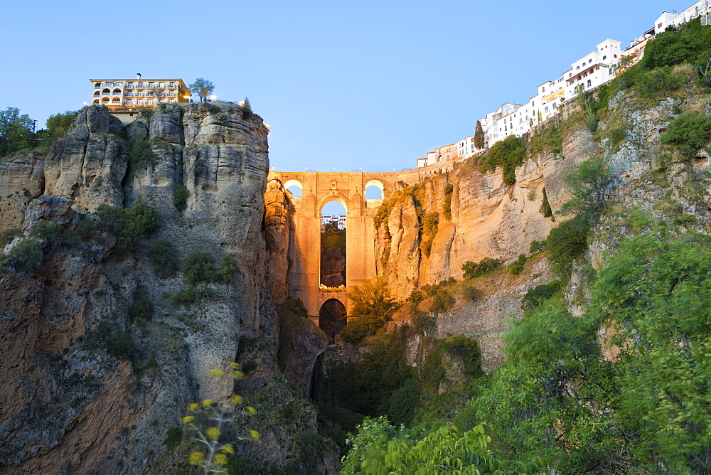 Puente Nuevo (New Bridge) floodlit at night and the white town perched on cliffs, Ronda, Andalucia, Spain, Europe - 846-2934