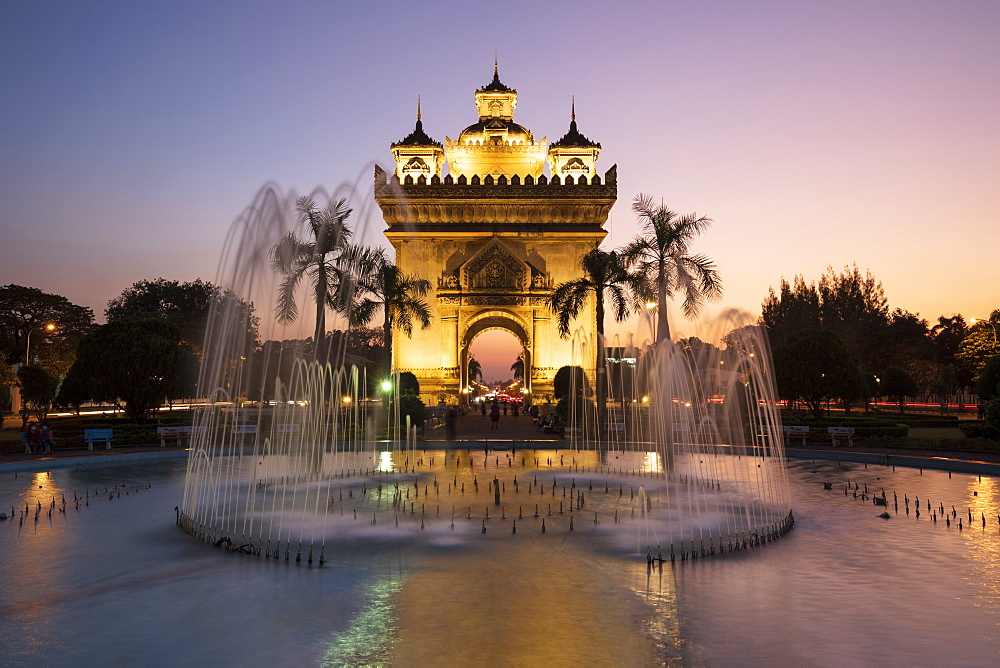 Patuxai Victory Monument (Vientiane Arc de Triomphe) and fountain floodlit at dusk, Vientiane, Laos, Indochina, Southeast Asia, Asia - 846-2998