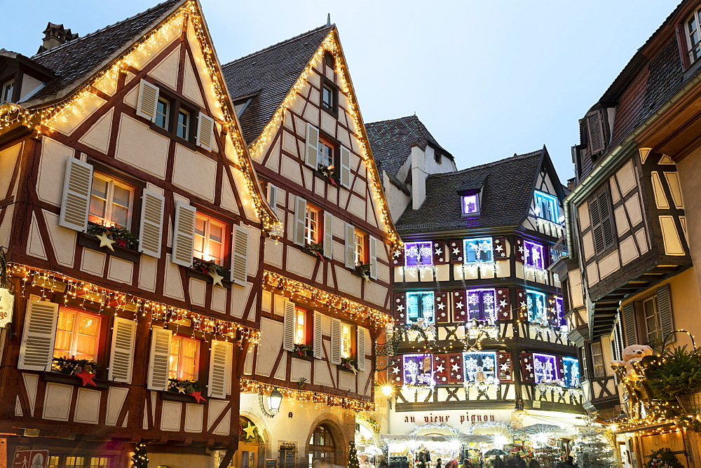 Half-timbered old buildings illuminated with Christmas decorations along the Rue des Marchands, Colmar, Alsace, France, Europe