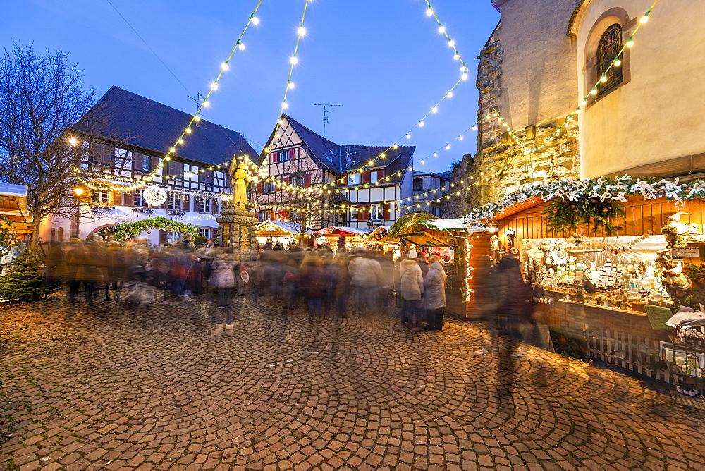 Christmas market at the Place du Marche aux Saules, Eguisheim, Alsace, France, Europe
