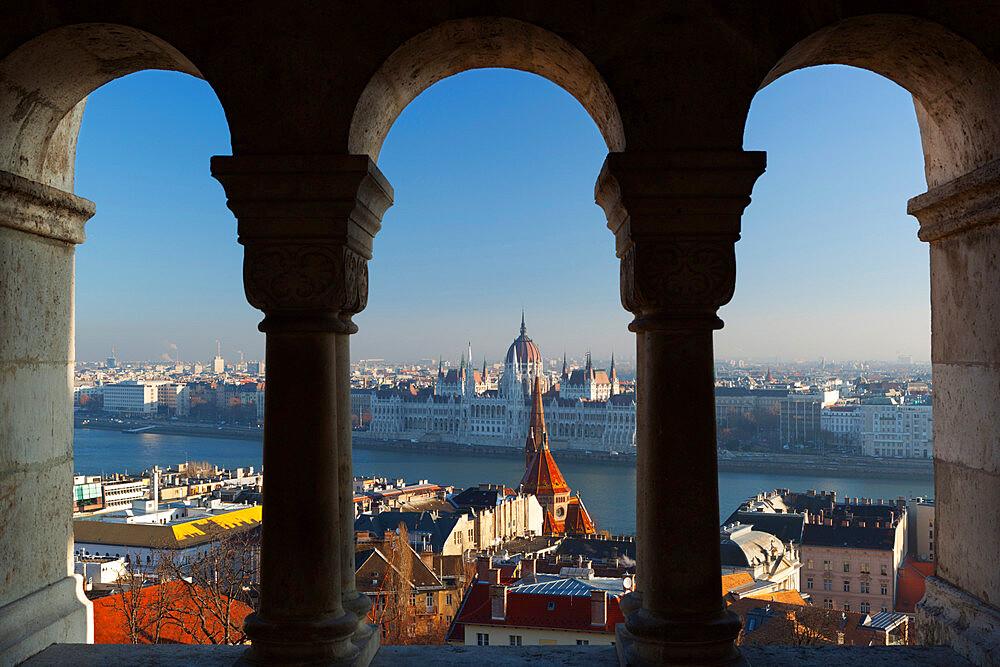 Parliament (Orszaghaz) and River Danube through arches of Fishermen's Bastion (Halaszbastya), UNESCO World Heritage Site, Buda, Budapest, Hungary, Europe - 846-463