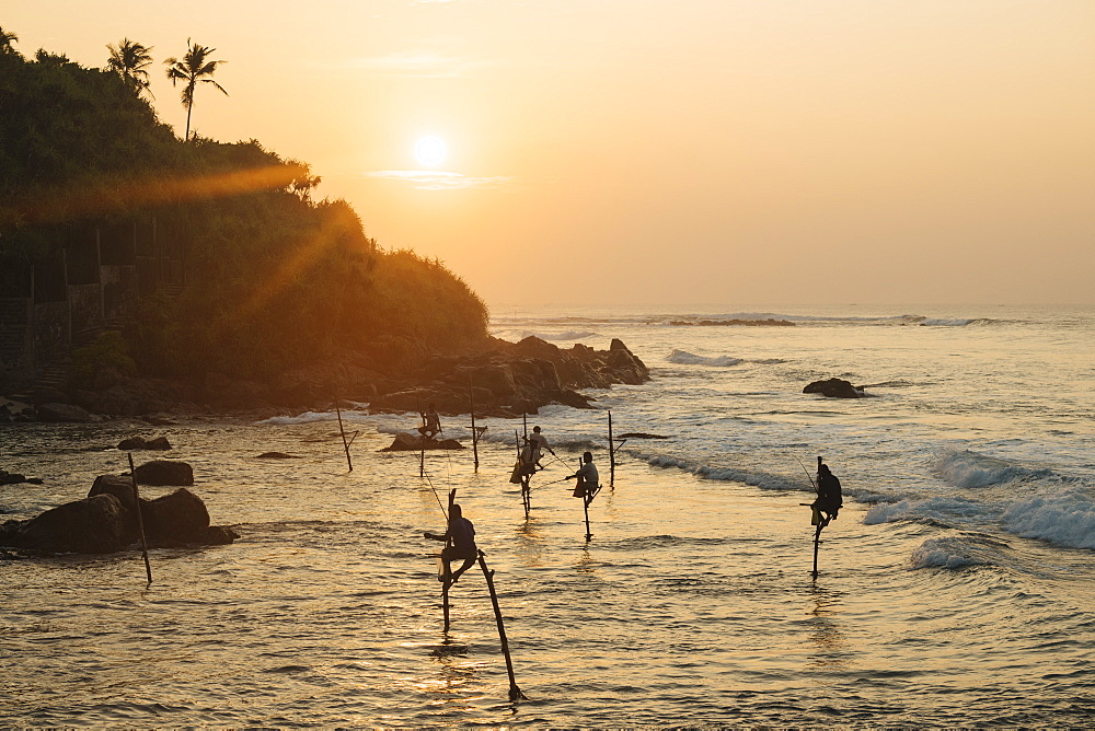 Stilt Fishermen at dawn, Weligama, South Coast, Sri Lanka, Asia - 848-1843