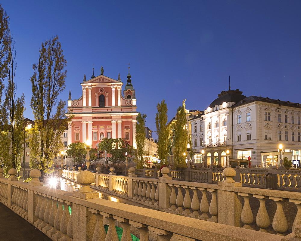 Franciscan Church of the Annunciation illuminated at night, Old Town, Ljubljana, Slovenia, Europe