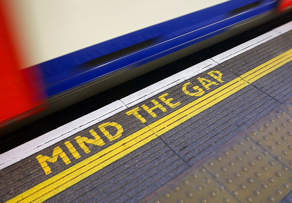 MIND THE GAP sign on platform edge, London Underground, London, England, United Kingdom, Europe