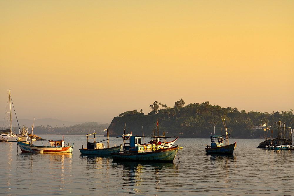 Boats in Mirissa harbour at sunset, Sri Lanka, Asia