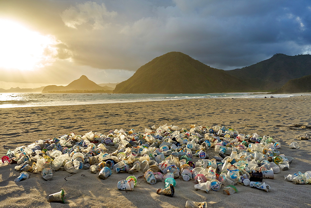 Pile of plastic rubbish dumped on the sand at sunset on Selong Belanak Beach on Lombok, Indonesia, Southeast Asia, Asia - 851-864