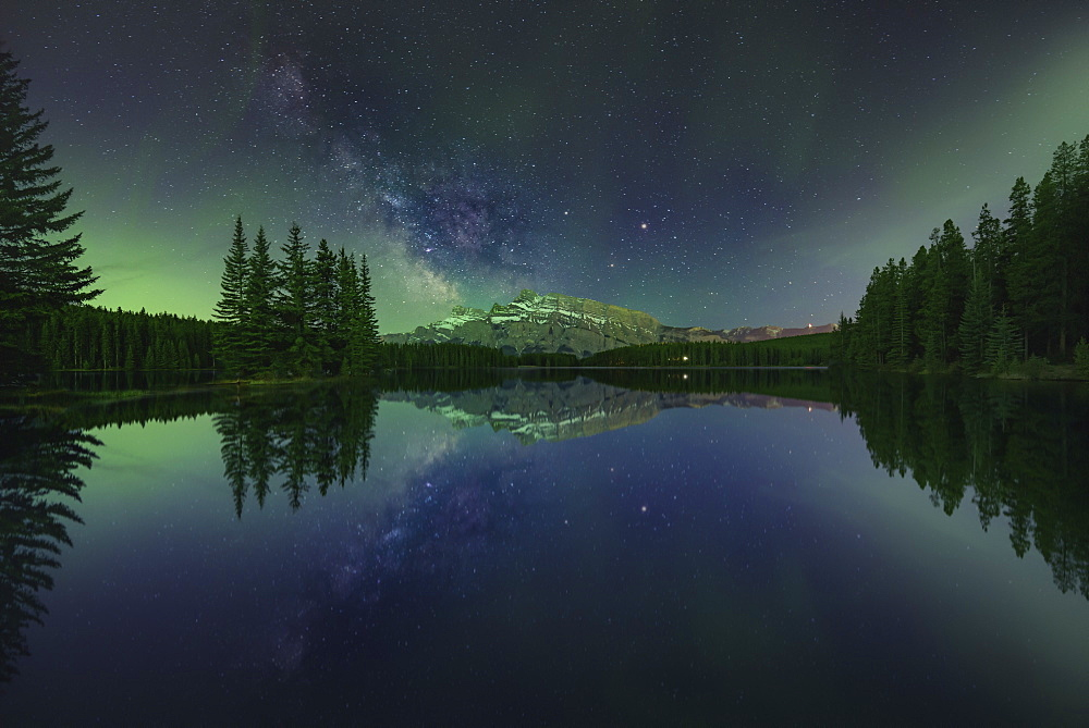 Two Jack Lake During Night With Aurora Borealis In Canada