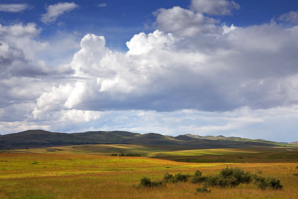 Summer Clouds Build Up Over The Grasslands Of The Canadian Prairies In Alberta