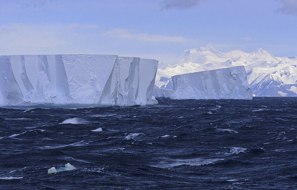 Tabular icebergs with Admiralty Mountains Range in background. Nearby Cape Adare, Ross Sea, Antarctica - 909-120