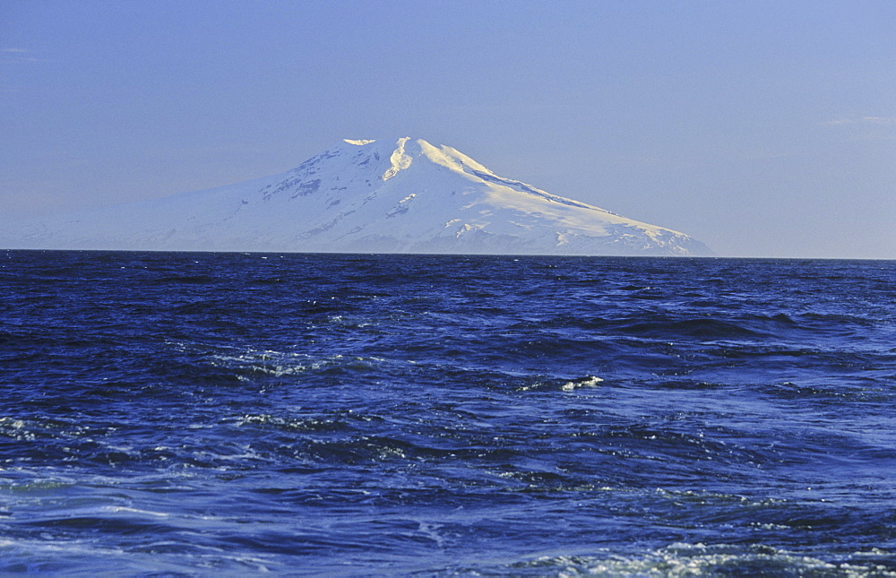 Summit of Mt Beerenberg, 2277m, seen from a long distance and the sea . Jan Mayen, North Atlantic Island - 909-98