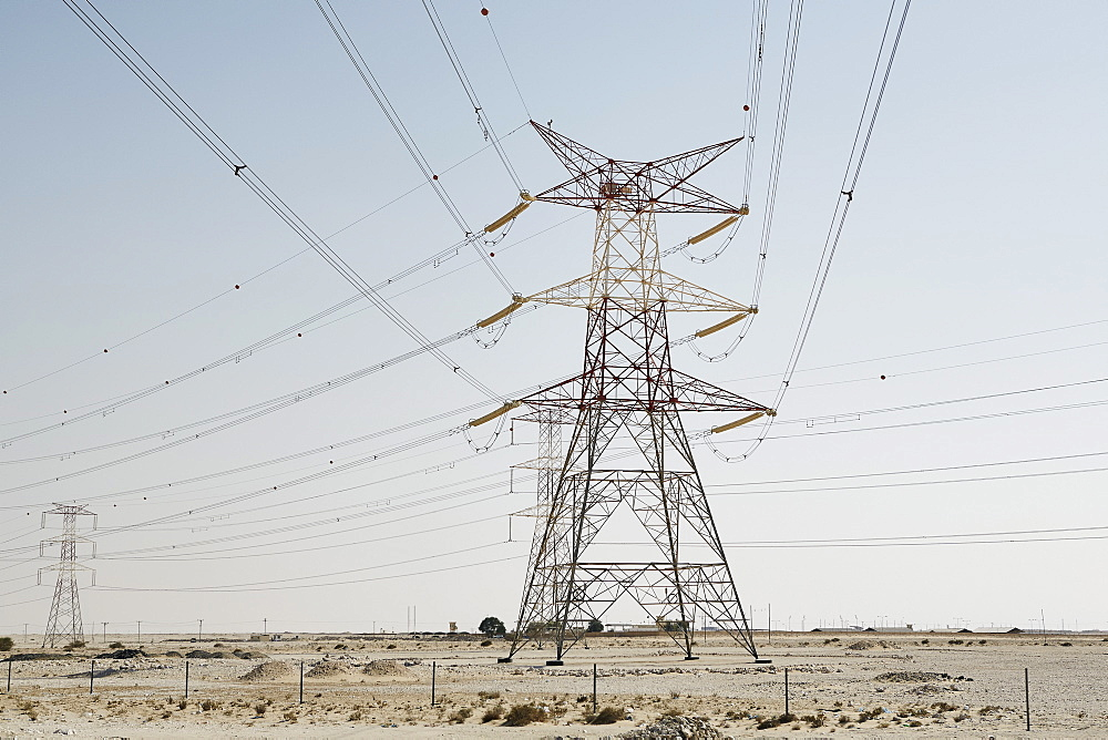 Electricity pylons dominate the desert skyline, Qatar, Middle East