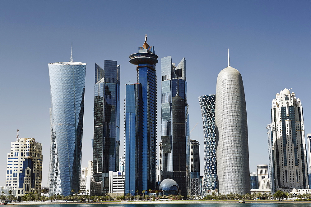 Downtown Doha with its impressive skyline of skyscrapers, Doha, Qatar, Middle East - 975-255