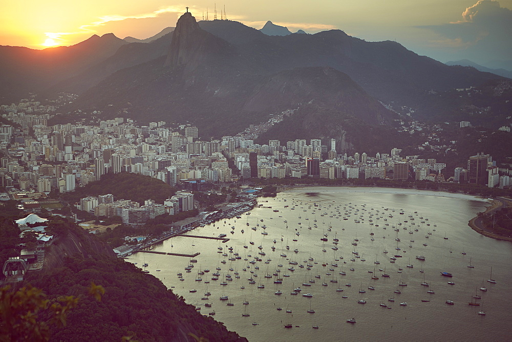 Views of Rio de Janeiro and Christ the Redeemer from Sugarloaf mountain (Pao de Acucar) at sunset, Rio de Janeiro, Brazil, South America - 975-301