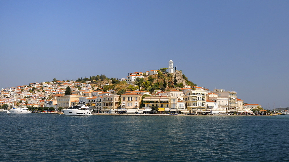 Poros town and harbour viewed from the sea, Poros island, Attica, Peloponnese, Greece, Europe - 989-409