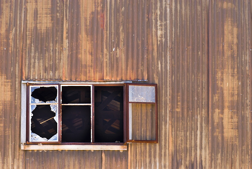 Sun rays through broken window, Old Canberra Brickworks, Canberra, Australian Capital Territory, Australia