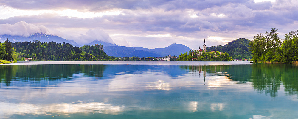 Lake Bled at sunrise with the Church on Lake Bled Island and Bled Castle, Gorenjska Region, Slovenia, Europe