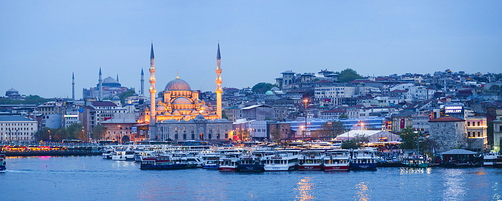 New Mosque (Yeni Cami) on the banks of the Golden Horn at night with Hagia Sophia (Aya Sofya) behind, Istanbul, Turkey, Europe