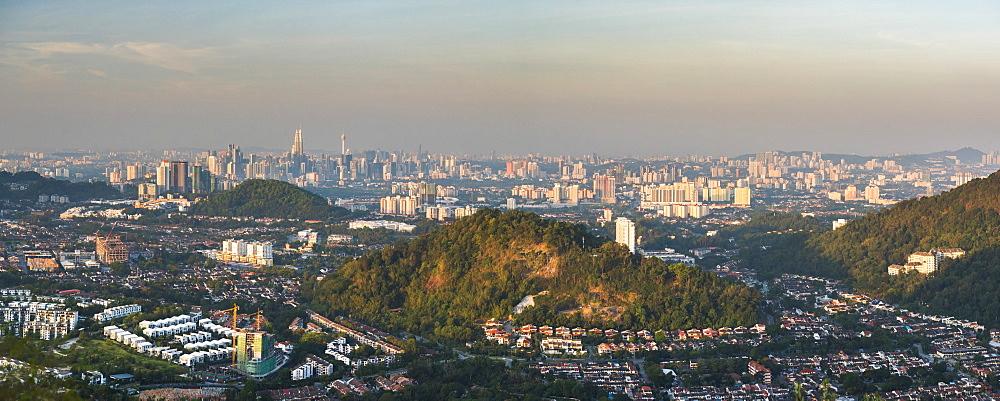 Kuala Lumpur skyline seen at sunrise from Bukit Tabur Mountain, Malaysia, Southeast Asia, Asia
