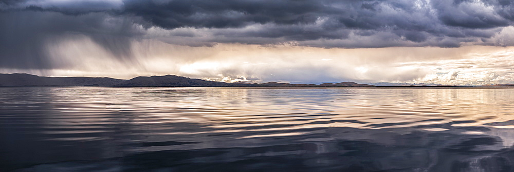 Dramatic storm clouds over Lake Titicaca, Peru