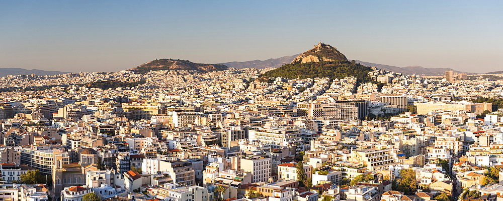 View of Athens and Likavitos Hill over the rooftops of the Plaka District from The Acropolis, Athens, Attica Region, Greece, Europe