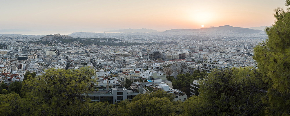 View over Athens and The Acropolis at sunset from Likavitos Hill, Athens, Attica Region, Greece, Europe
