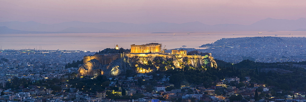 View over Athens and The Acropolis, UNESCO World Heritage Site, at sunset from Likavitos Hill, Athens, Attica Region, Greece, Europe