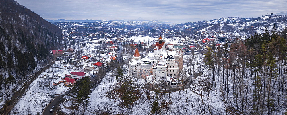 Bran Castle covered in snow in winter, Transylvania, Romania drone - 1109-3713