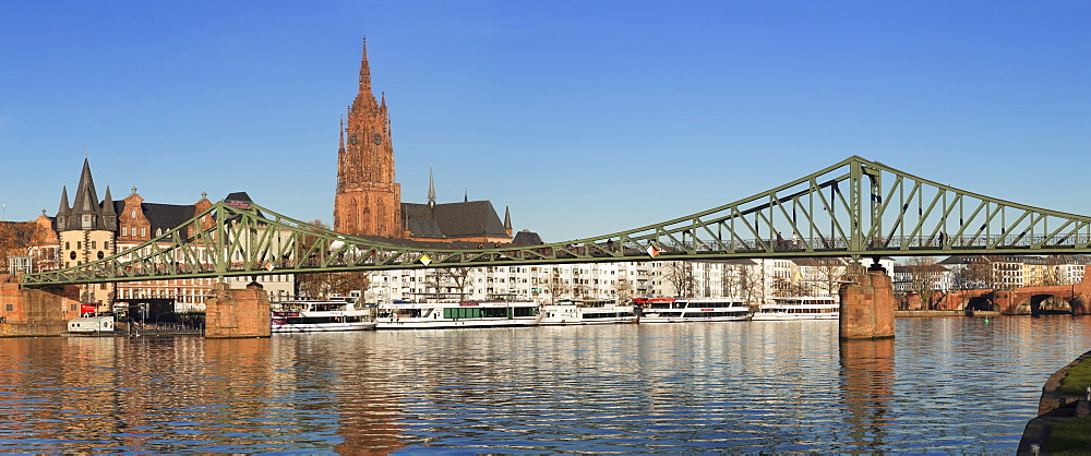 View over Main River to Eiserner Steg iron footbridge and Kaiserdom Cathedral of St. Bartholomew, Frankfurt, Hesse, Germany, Europe